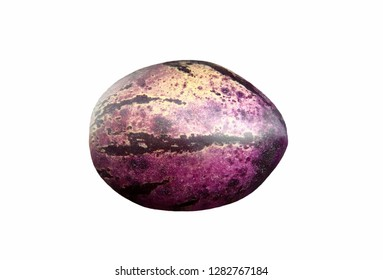 A ripe pepino melon /Solanum muricatum/ showing the characteristic purple striping, isolated on white background