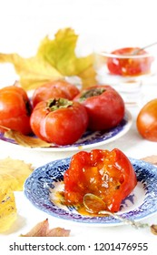 ripe persimmon is eaten with a spoon like jam. juicy persimmon. autumn fruit