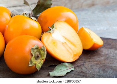 ripe persimmon on wooden background