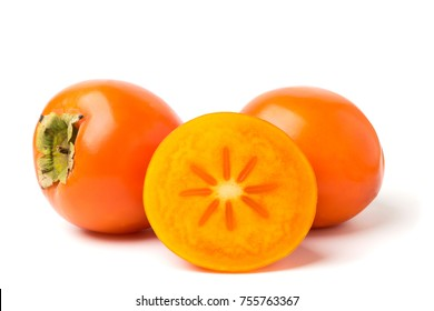 Ripe persimmons on white background, isolated. Fruits closeup