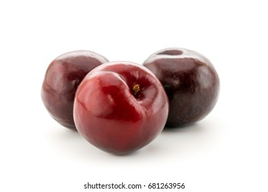 Ripe plums on white, isolated
