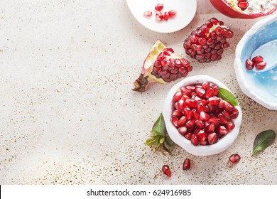 Ripe pomegranate fruit on a marble  background free text space, top view.