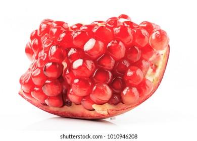 Ripe pomegranate fruit on white background