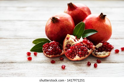 Ripe pomegranate fruits on  wooden vintage background