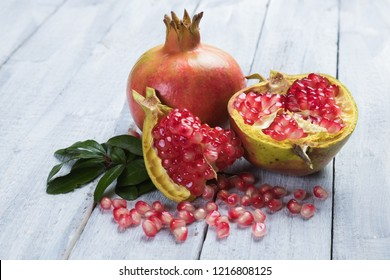 Ripe pomegranate, mediterranean fruit opened with red seeds