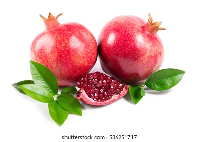 Ripe pomegranates with leaves on white background