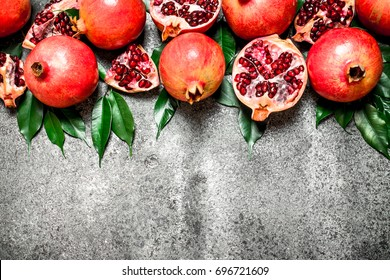 Ripe pomegranates. On rustic background. Top view