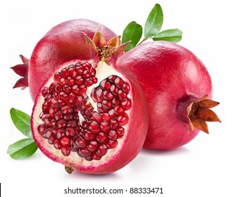 Ripe pomegranates with pomegranate leaves isolated on a white background.