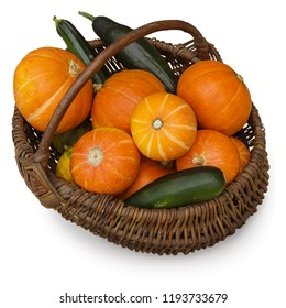 Ripe pumpkin and zucchini in wicker basket. Harvest and autumn concept