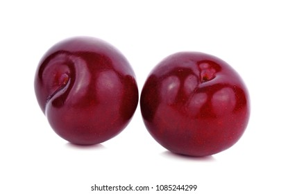 Ripe purple cherry plums, isolated on white background