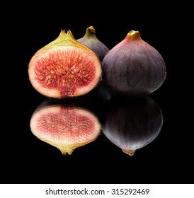 ripe purple figs isolated on white background