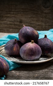 Ripe purple figs on old boards