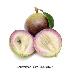 Ripe purple star apple fruit with half isolated on white background