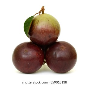ripe purple star apple fruits with leaf isolated on white background