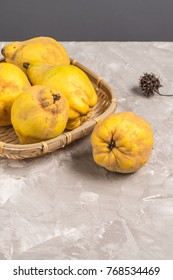 Ripe quince fruits on kitchen countertop.