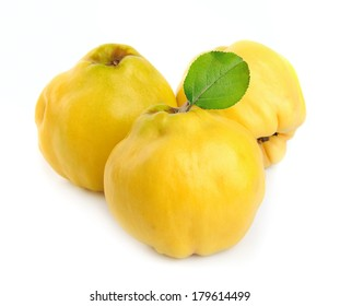 Ripe quince with leaves on a white background