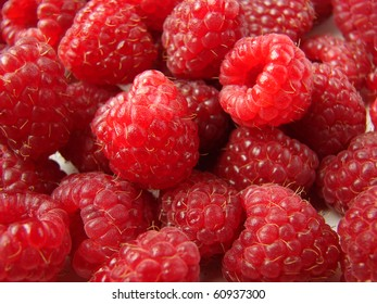 lot of ripe raspberries background