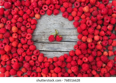 Ripe raspberry on a background of old boards