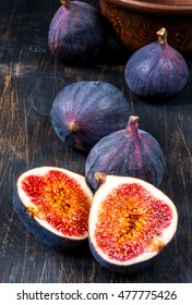 Ripe raw figs on a black wooden table