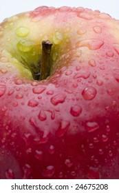 Ripe red apple, sprinkeld with water.