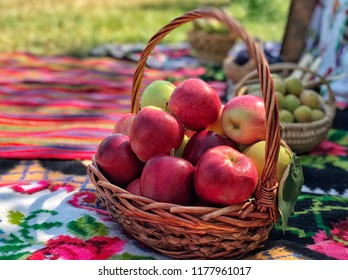 ripe red apples in a basket