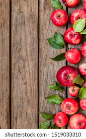 Ripe Red Apples with Leaves, Old Wood Background, copy space for your text