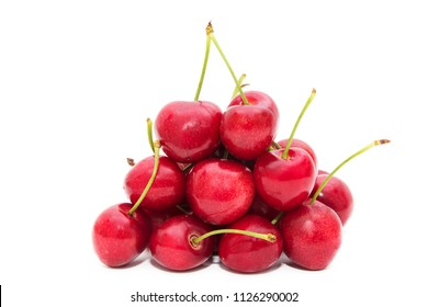 ripe red cherries isolated in white background