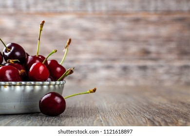 Ripe Red Cherries in a tin flan dish