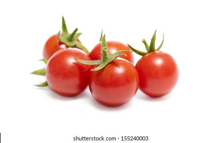 Ripe red cherry tomatoes on white background.