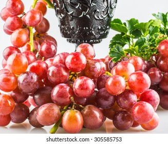 Ripe red grapes with white back ground