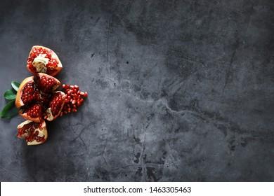 Ripe red pomegranate. Ripe grains of pomegranate on the table. Pomegranate juice.