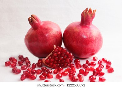 ripe, red pomegranates grown in a garden in autumn