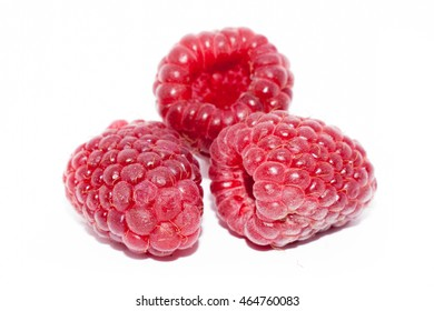 Ripe red raspberry fruit isolated on white background