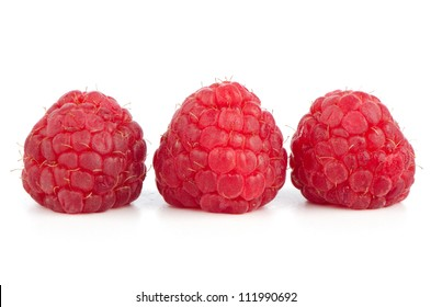 Ripe red raspberry on white background.