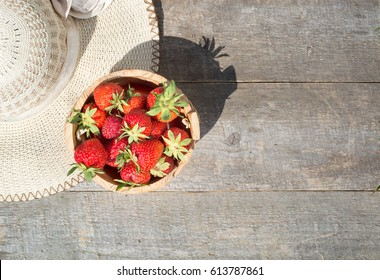 Ripe red strawberries on wooden table. top view. copy space