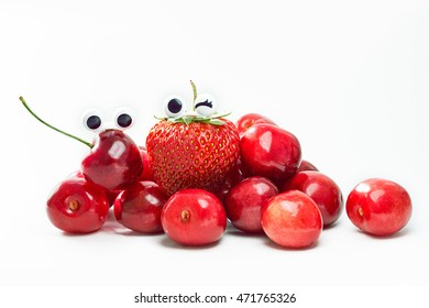 Ripe red ?herries and strawberry with funny emotions isolated on white background