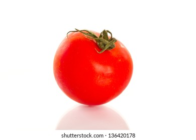 ripe red tomato close up on a white background