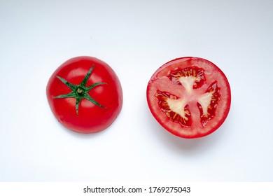 Ripe red tomato on white background