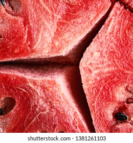Ripe red watermelon pulp with big cracks background close-up. Texture of ripe watermelon pulp.