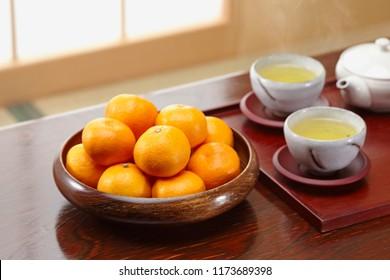 Ripe seedless satsumas (Citrus unshiu) in japanese room