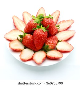 Ripe strawberries in dish isolated on white