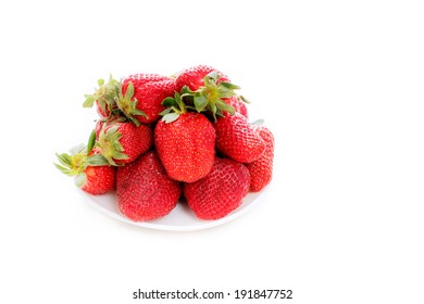 Ripe strawberries on the saucer isolated on white background close-up