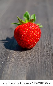 Ripe strawberries on the table. Berries on a dark background. Strawberry and strawberry photo