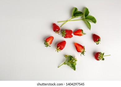 Ripe strawberries on white background