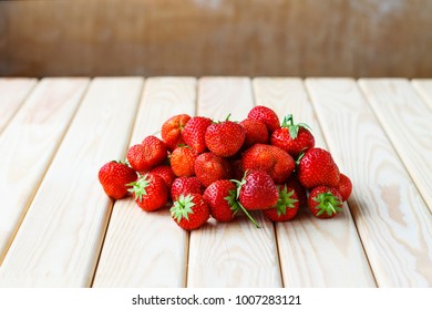 Ripe strawberries on a wooden table