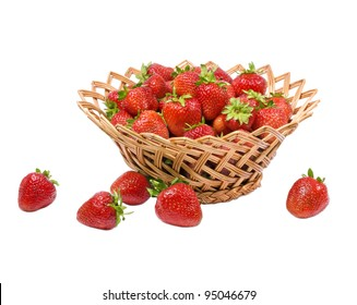 Ripe strawberries in a wicker basket isolated on a white background