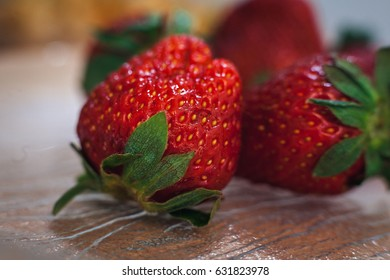 Ripe strawberry with green leaves