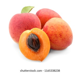 Ripe sweet apricots on white background