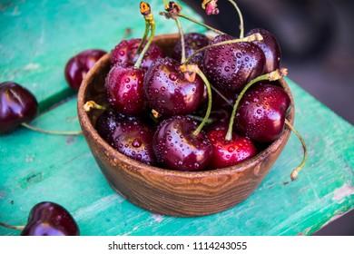 Ripe sweet cherries in drops of water. Fruits and berries.