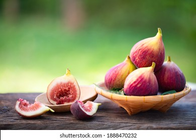 Ripe sweet figs. Healthy mediterranean fig fruit and slice figs on rustic wooden background